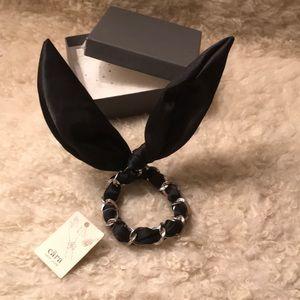 CARA New York: satin bracelet wristlet with bow.